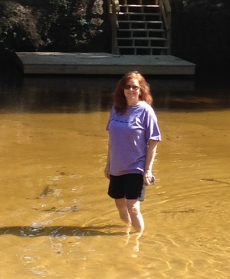 Mary wading in the Styx River Robertsdale Alabama